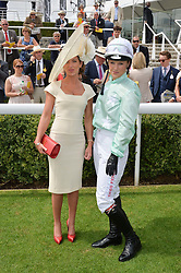 Left to right, KERRI RADCLIFFE and LEONORA SMEE at the 2014 Glorious Goodwood Racing Festival at Goodwood racecourse, West Sussex on 31st July 2014.