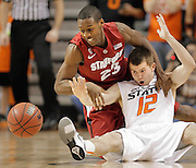 Stanford's Gabriel Harris fouls Oklahoma State's Keiton Page on loose ball scramble in Stillwater, OK.