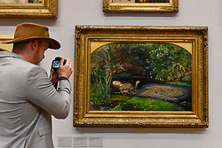 "© Licensed to London News Pictures. 05/09/2018. LONDON, UK.  A visitor photographs ""Ophelia"", 1851-52, by John Everett Millais, at Tate Britain, ahead of the launch of a major new exhibition at the National Gallery of Australia (NGA) in December 2018.  Over forty Pre-Raphaelite works will be loaned by Tate to NGA, which have never been shown in Australia until now, including ""Ophelia"", 1851-52, by John Everett Millais and ""The Lady of Shalott"", 1888, by John William Waterhouse.  Photo credit: Stephen Chung/LNP"