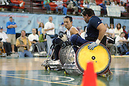 July 7th, 2006: Anchorage, AK - William Groulx (10) keeps the ball away from Blue team hard hitter Scot Severn as White defeated Blue in the gold medal game of Quad Rugby at the 26th National Veterans Wheelchair Games.