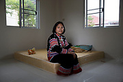 Yuphin Saja, a member of the Lahu minority group in the safe house she has been forced to move to with her husband and small children for their own protection after a member of the group was allegedly shot dead at a checkpoint.