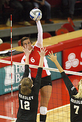 22 September 2012:  Brooklyn Hlafka strikes towards Jessie Tulacka and Amy Angelos  during an NCAA womens volleyball match between the Bradley Braves and the Illinois State Redbirds at Redbird Arena in Normal IL