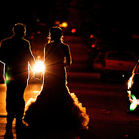 Erin and Joe walk down a street the night of their Brooklyn wedding.
