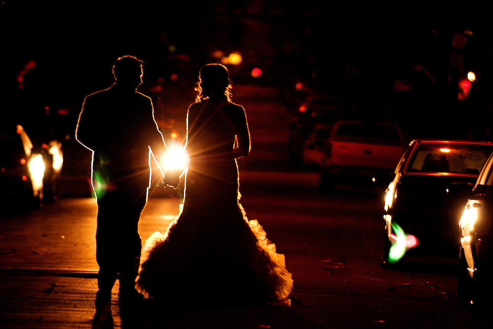 Erin and Joe walk down a street the night of their Brooklyn wedding.