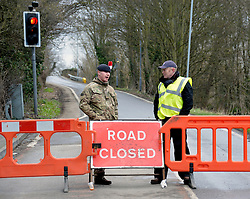 Army and local residents man road blocks to prevent any looting in the area, United Kingdom, Wednesday 12th February 2014. Picture by David Dyson / i-Images