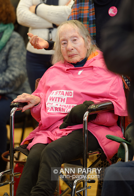 "Westbury, New York, USA. January 15, 2017. Sitting in wheelchair, PEARL BERGER, 97, of Amityville, who has breast cancer and Parkinson's Disease, has an ""I STAND WITH PLANNED PARENTHOOD"" pink shirt draped on her chest, at the ""Our First Stand"" Rally against Republicans repealing the Affordable Care Act, ACA, taking millions of people off health insurance, making massive cuts to Medicaid, and defunding Planned Parenthood."