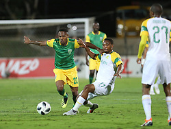 Durban, SOUTH AFRICA - SEPTEMBER 19: Sibusiso Vilakazi and Sibusiso Sibeko going for a ball during the Absa Premiership match between Golden Arrows and Mamelodi Sundowns at Princess Magogo Stadium on September 19, 2018 in Durban, South Africa. (Photo by Motshwari Mofokeng/ANA)