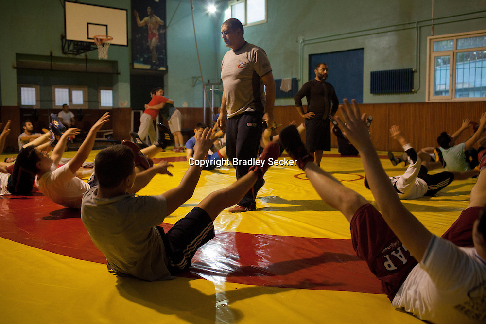 A training session for young wrestlers in Istanbul's Haydarpaşa Demirspor centre in Kadıköy, Istanbul, Turkey. The classes usually have between 25 to 30 particupants ranging in age and experience.