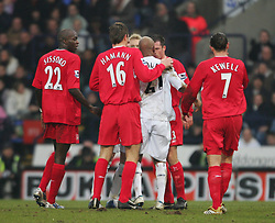 BOLTON, ENGLAND - MONDAY, JANUARY 2nd, 2006: Liverpool's Jamie Carragher argues with Bolton Wanderers' El Hadji Diouf during the Premiership match at the Reebok Stadium.(Pic by David Rawcliffe/Propaganda)