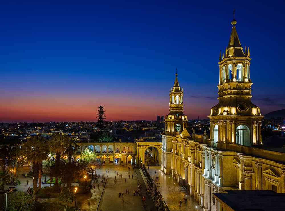 AREQUIPA, PERU - CIRCA SEPTEMBER 2019:  The Basilica Cathedral of Arequipa and Plaza de Armas at dusk. It is the most important Catholic church of the city. The cathedral is also considered one of Peru's most unusual and famous colonial cathedrals since the Spanish conquest.