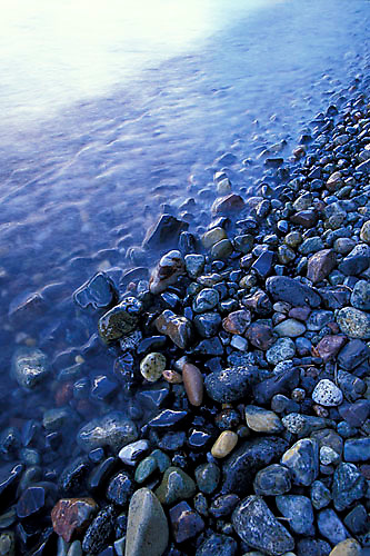 Small waves washing upon pebbles on Fallen Leaf Lake, CA.<br />