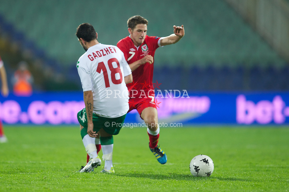 SOFIA, BULGARIA - Tuesday, October 11, 2011: Wales' Joe Allen in action against Bulgaria during the UEFA Euro 2012 Qualifying Group G match at the Vasil Levski National Stadium. (Pic by David Rawcliffe/Propaganda)