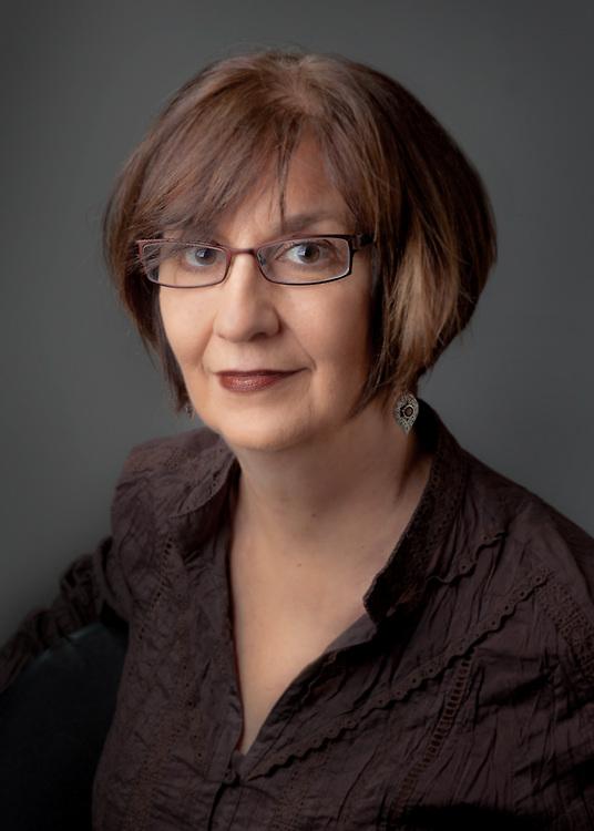 Susan Polaskis:  http://poulakisdesign.com/info/