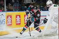KELOWNA, CANADA - NOVEMBER 6: Carter Rigby #11 of the Kelowna Rockets fights for the puck against the Red Deer Rebels on NOVEMBER 6, 2013 at Prospera Place in Kelowna, British Columbia, Canada.   (Photo by Marissa Baecker/Shoot the Breeze)  ***  Local Caption  ***