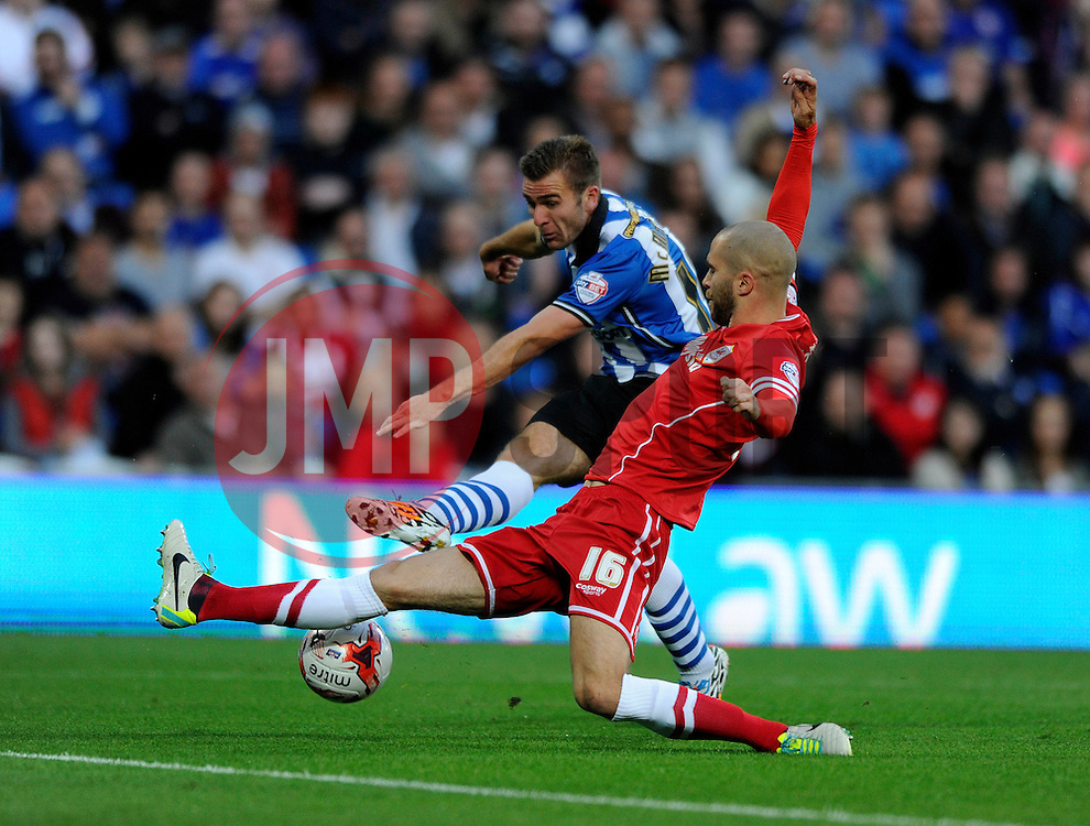 Wigan Athletic's Callum McManaman takes a shot at goal which is blocked by Cardiff City's Matthew Connolly - Photo mandatory by-line: Dougie Allward/JMP - Mobile: 07966 386802 19/08/2014 - SPORT - FOOTBALL - Cardiff - Cardiff City Stadium - Cardiff City v Wigan Athletic - Sky Bet Championship