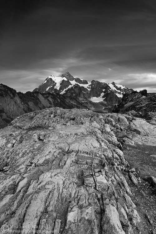Rocky ridge at Artist Point with Mount Shuksan in the background. Artist Point is in Washington State's North Cascades Range.  Mount Shuksan itself lies in North Cascades National Park.