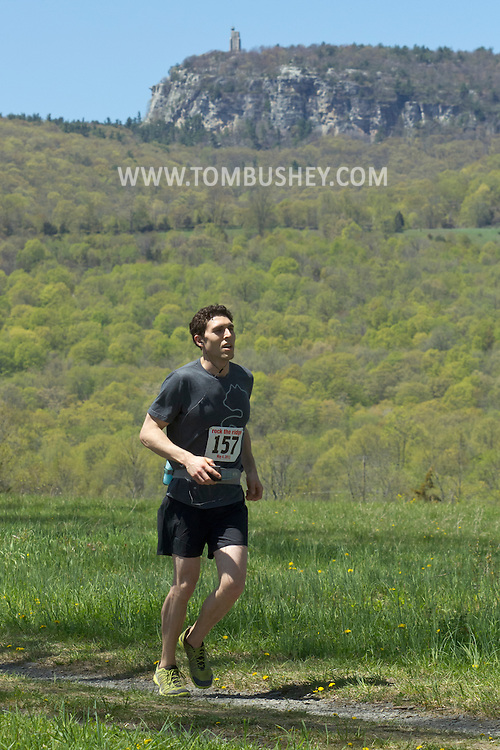 Gardiner, New York - Daniel Lebrost nears the finish line in the Rock the Ridge 50-mile endurance challenge race at the Mohonk Preserve on May 4, 2013. The race is part of Mohonk's 50th anniversary celebration and a fundraiser for the preserve.
