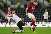 Derby County forward Wayne Rooney wins the ball from Northampton Town forward Andy Williams during the The FA Cup match between Derby County and Northampton Town at the Pride Park, Derby, England on 4 February 2020.