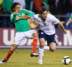 United States forward Clint Dempsey (8) fights off Mexico midfielder Israel Martinez (14) to keep the ball.  The United States men's soccer team defeated the Mexican national team 2-0 in CONCACAF final group qualifying for the 2010 World Cup at Columbus Crew Stadium in Columbus, Ohio on February 11, 2009.
