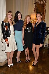 Left to right, SUKI WATERHOUSE, DAISY LOWE, CLARA PAGET and CARA DELEVINGNE at a party hosed by the US Ambassador to the UK Matthew Barzun, his wife Brooke Barzun and editor of UK Vogue Alexandra Shulman in association with J Crew to celebrate London Fashion Week held at Winfield House, Regent's Park, London on 16th September 2014.