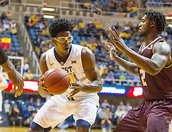 Dec 13, 2015; Morgantown, WV, USA; West Virginia Mountaineers forward Devin Williams (41) drives to the basket during the first half against the Louisiana Monroe Warhawks at WVU Coliseum. Mandatory Credit: Ben Queen-USA TODAY Sports
