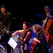 May 14, 2011 - Manhattan, NY : .The Otero Quintet, comprised of Gabrielle Fink (violin), Adam Fisher (cello), Pablo Asian (bass), JP Jofre (bandoneon) and Fernando Otero (piano - not pictured here) perform Fernando Otero's 'Sonata Morrisan Manifestacion Globalizacion De Ahoralen Mas' during Symphony Space's Wall to Wall Sonidos concert on Saturday night. .CREDIT: Karsten Moran for The New York Times