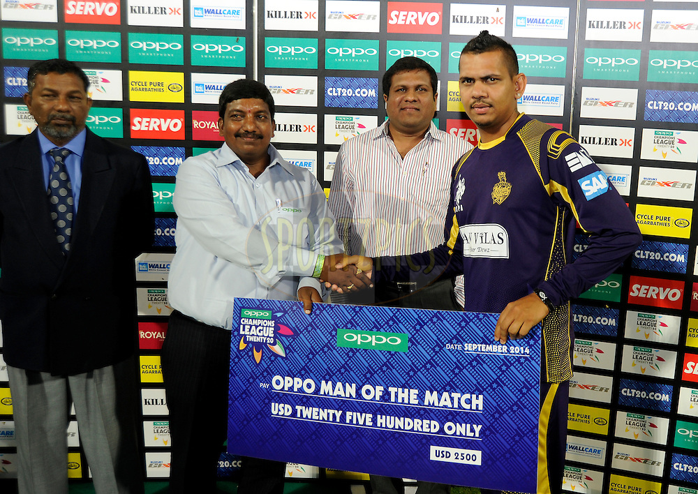 Sunil Narine of Kolkata Knight Riders receives the Oppo Man of the match award during the presentation after match 7 of the Oppo Champions League Twenty20 between the Kolkata Knight Riders and the Lahore Lions held at the Rajiv Gandhi Cricket Stadium, Hyderabad, India on the 21st September 2014<br /> <br /> Photo by:  Pal Pillai / Sportzpics/ CLT20<br /> <br /> <br /> Image use is subject to the terms and conditions as laid out by the BCCI/ CLT20.  The terms and conditions can be downloaded here:<br /> <br /> http://sportzpics.photoshelter.com/gallery/CLT20-Image-Terms-and-Conditions-2014/G0000IfNJn535VPU/C0000QhhKadWcjYs