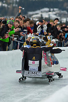 The German team of Karl Angerer, Andreas Udvari, Thomas Poege, and Gregor Bermbach compete in the Mens' four-person bobsleigh World Cup competition held at the Whistler Sliding Centre on Feb 7, 2009