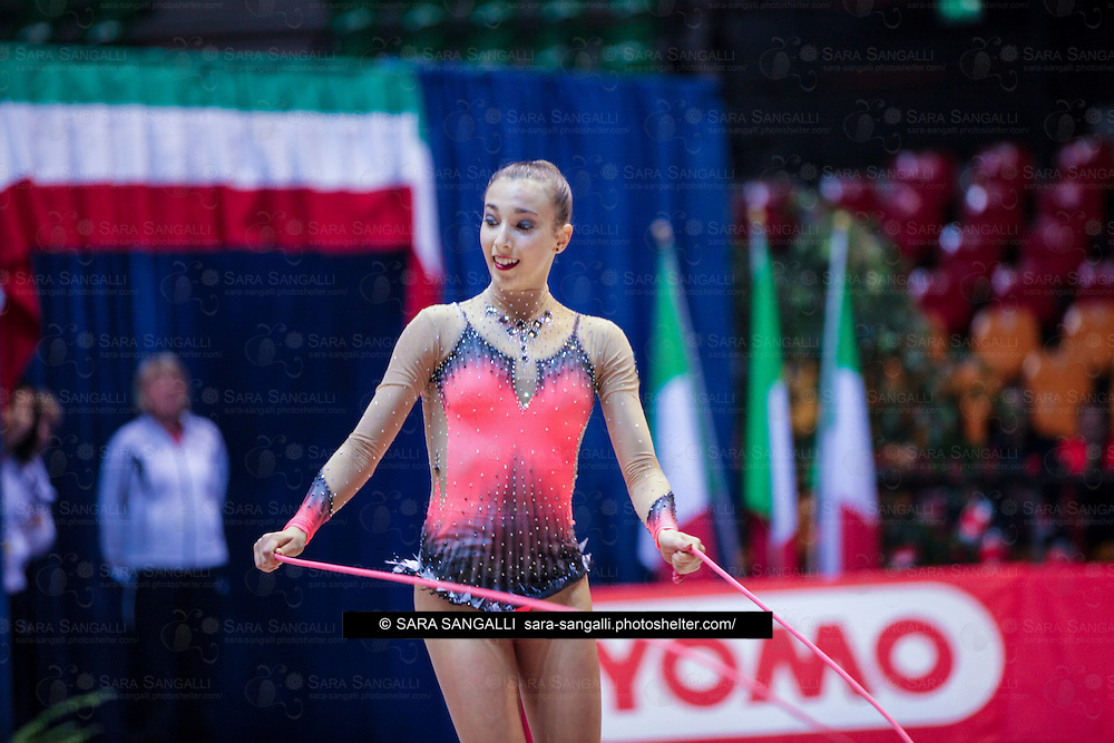 DESIO, ITALY - OCTOBER 31 2015: Gilda de Vecchis of Ritmica Nervianese performs with rope at the italian national rhythmic gymnastic championship. Her score in the apparatus is 13,550. Her team's score is 81,900 and ended up in seventh position.
