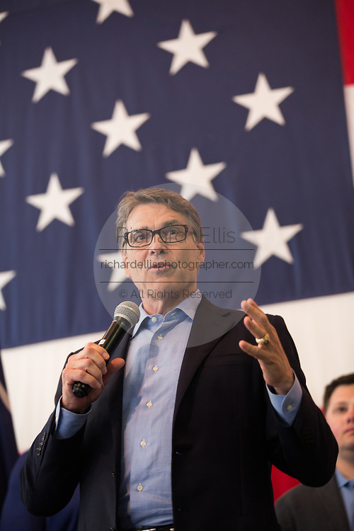 Former Texas Governor and GOP presidential hopeful Rick Perry joins a group of military veterans for a town hall campaign event aboard the USS Yorktown June 8, 2015 in Mount Pleasant, South Carolina.