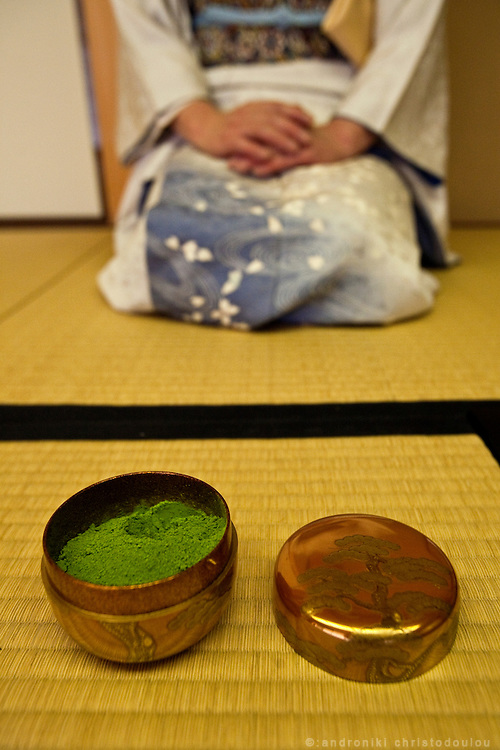 Japanese woman preparing tea during a tea ceremony.