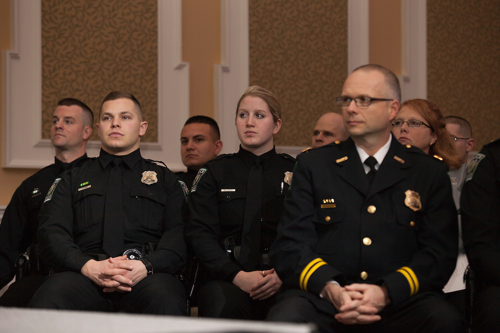 Ohio University police officers listen to President Roderick McDavis speak at the Badge Pinning and Employee Recognition Ceremony on Monday, February 8, 2016. Photo by Kaitlin Owens