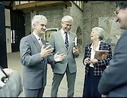 10/09/1988<br /> 09/10/1988<br /> 10 September 1988<br /> ROSC 1988 Exhibition at the Guinness Hop Store. <br /> Sir Norman Macfarlane, (centre) Chairman of Guinness plc.  and Lady Gretta Macfarlane (right) being entertained by Mr Pat Murphy, (left) Chairman of ROSC during Sir Norman's visit to ROSC '88.