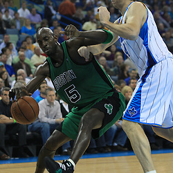 11 February 2009:  Boston Celtics forward Kevin Garnett (5) drives past forward Sean Marks (4) during a NBA game between the Boston Celtics and the New Orleans Hornets at the New Orleans Arena in New Orleans, LA.