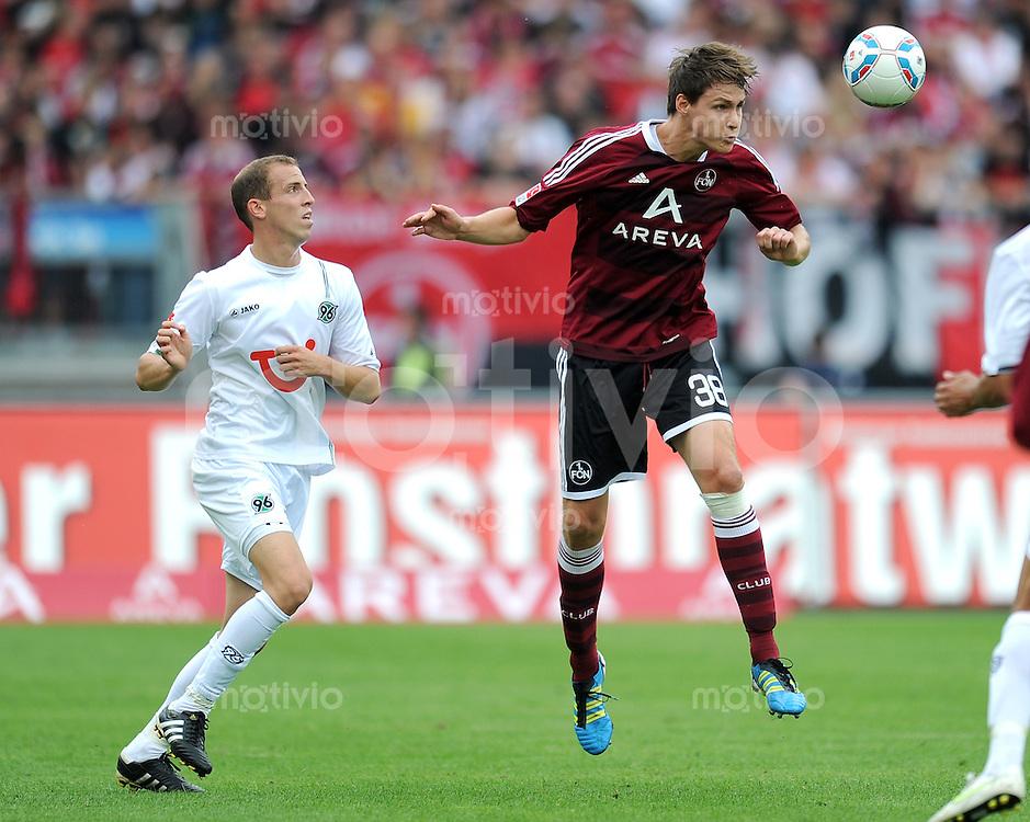 FUSSBALL   1. BUNDESLIGA  SAISON 2011/2012   2. Spieltag 1 FC Nuernberg - Hannover 96          13.08.2011 Jan Schlaudraff (li, Hannover 96) gegen Philipp Wollscheid (re, 1 FC Nuernberg)