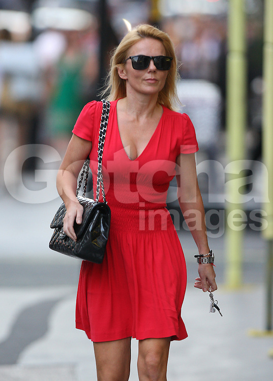 Lady in red Geri Halliwell wearing a red dress, Chanel handbag and a pair of silver high heels, seen arriving in her old classic sport Mercedes-Benz at the West London Mission Of The Methodist Church. The former Spice Girl spent about 40 minutes at the church before going to The Kabbalah Centre in London's west end. Geri left the Kabbalah Centre 3 and a half hours later and headed home... 07/09/2012<br />BYLINE MUST READ : GOTCHAIMAGES.COM<br /><br />Copyright by © Gotcha Images Ltd. All rights reserved.<br />Usage of this image is conditional upon the acceptance <br />of Gotcha Images Ltd, terms and conditions available at<br />www.gotchaimages.com