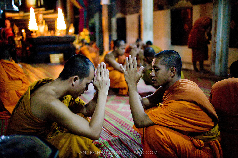 Cambodian monks prayer during the evening gathering at their wat in Siem Reap, Cambodia.