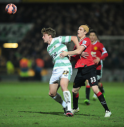 Yeovil Town's Tom Eaves battles for the ball with Manchester United's Paddy McNair  - Photo mandatory by-line: Joe meredith/JMP - Mobile: 07966 386802 - 04/01/2015 - SPORT - football - Yeovil - Huish Park - Yeovil Town v Manchester United - FA Cup - Third Round