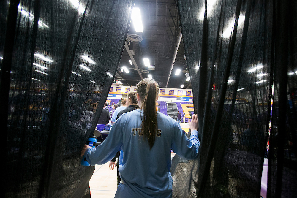 03/21/2014- Stevens Point, Wisc. -  Emma Roberson, A16, and the rest of the Tufts women's basketball game walk through the curtain into the Quandt Fieldhouse to face FDU-Florham in their NCAA Division III Women's Final Four game on Mar. 21, 2014. (Kelvin Ma/Tufts University)