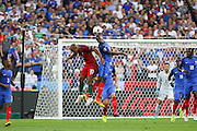 France Midfielder Blaise Matuidi beats Portugal Midfielder Joao Mario in the air with a header during the Euro 2016 final between Portugal and France at Stade de France, Saint-Denis, Paris, France on 10 July 2016. Photo by Phil Duncan.