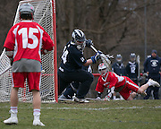 Kevin Maguire of Pittsford in net during a game in Canandaigua on Saturday, April 11, 2015.