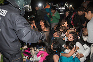 Berlin, Germany - 22-23.05.2016<br /> <br /> About 50 Sinti &amp; Roma protest against their acute deportations and occupy  along with supporters the Memorial to the Sinti &amp; Roma Victims of National Socialism in Berlin's government district. In talks with the Director of the Foundation Memorial to the Murdered Jews of Europe Uwe Neumaerker, the Green politican Volker Beck and others they try to get the permission to stay at least until the next morning at the memorial. By order of the president of the Bundestag began shortly after midnight the police eviction of the protest. An hour earlier jumped two Roma in the water basin of the monument to protest agains the planed eviction of the occupation memorial. Immediately after this, a woman who also jumped in the water became a strong epileptic seizure. She was supervised on site by paramedics and doctors, Because of the concern that they will be deported directly out of the hospital, she refused a transfer to hospital.<br /> <br /> Aus Protest gegen ihre akut drohenden Abschiebungen besetzten etwa 50 Sinti &amp; Roma zusammen mit Unterstuetzer das Denkmal f&uuml;r die ermordeten Sinti und Roma Europas im Berliner-Regierungsviertel. In Gespraechen u.a. mit Uwe Neumaerker, dem Direktor der Stiftung Denkmal f&uuml;r die ermordeten Juden Europas und dem Gruenen Politiker Volker Beck versuchten sie zu erreichen, zumindest bis zum naechsten Vormittag am Mahnmal bleiben zu koennen. Auf Anordnung des Bundestagspraesidenten begann um kurz nach Mitternacht die polizeiliche Raeumung der Aktion. Bereits eine Stunde zuvor sprangen zwei Roma in das Wasserbecken des Denkmals um gegen eine drohende Raeumung des Besetzung zu protestieren. Unmittelbar danach bekam eine Frau die mit ins Wasserbecken sprang einen starken Epileptischen Anfall. Sie wurde vor Ort von Sanitaetern und Aerzten betreut, lehnte einen dringend angeratenen Transport ins Krankenhaus jedoch ab, da sie Angst hatte, ansonsten aus dem Krankenhaus heraus abgeschoben 