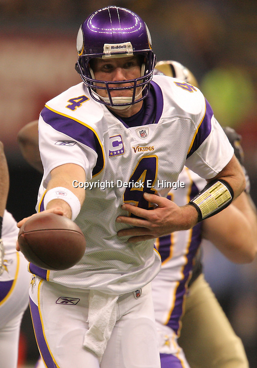 Jan 24, 2010; New Orleans, LA, USA; Minnesota Vikings quarterback Brett Favre (4) looks to hand off during a 31-28 overtime victory by the New Orleans Saints over the Minnesota Vikings in the 2010 NFC Championship game at the Louisiana Superdome. Mandatory Credit: Derick E. Hingle-US PRESSWIRE
