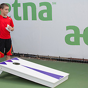 August 16, 2014, New Haven, CT:<br /> A young fan throws a beanbag during a tennis clinic in the AETNA FitZone as part of Kids Day on day three of the 2014 Connecticut Open at the Yale University Tennis Center in New Haven, Connecticut Sunday, August 17, 2014.<br /> (Photo by Billie Weiss/Connecticut Open)