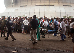 01 Sept, 2005. New Orleans, Louisiana.<br /> Mass evacuation of New Orleans begins. People collapse in the heat as massed crowds await their call to busses taking them out of New Orleans. <br /> Photo©; Charlie Varley/varleypix.com