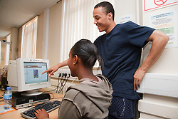 Students working on computer.