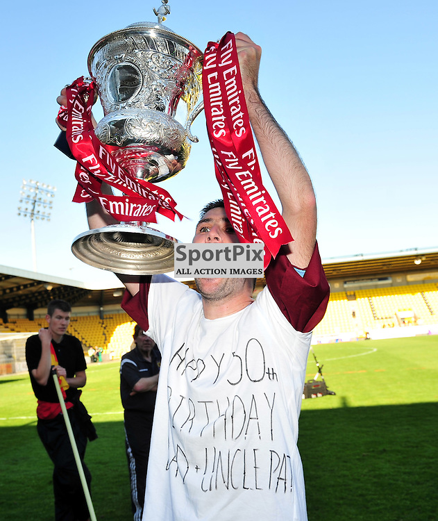 Paul Burns lifts the cup..Auchinleck Talbot v Shotts Bon Accord, Emirates Junior Cup Final,  Sunday 27th May 2012..ALEX TODD | STOCKPIX.EU