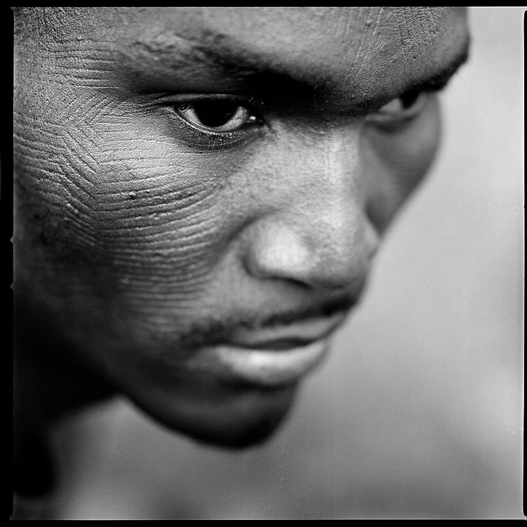 "Benin - January 2009 - ""My friends asked me if it hurt and if I cried, and I said'no',"" explains Thomas from Natitingou, after receiving his scarifications. The ceremony have a process of initiation is of great social importance and the rites of the ritual have special symbolic meanings. Scarification is used as a form of initiation into adulthood, beauty and a sign of a village, tribe, and clan."