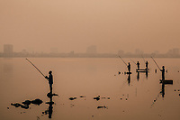 Fishermen on West Lake in Hanoi, Vietnam.