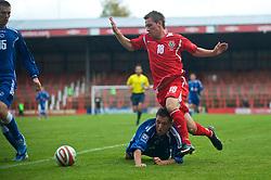 WREXHAM, WALES - Saturday, October 10, 2009: Wales' Elliot Chamberlain and Bosnia-Herzegovina's Boris Savic during the UEFA Under-21 Championship Qualifying Round Group 3 match at the Racecourse Ground. (Pic by Chris Brunskill/Propaganda)